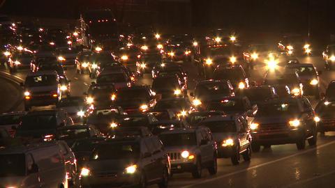 Static, medium shot of traffic at night in Atlanta, Georgia Footage