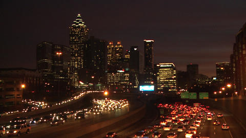 Static, wide, very dark, nighttime shot of the lit up Atlanta Skyline with traff Footage