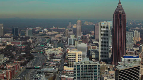 A static, high, wide shot of the Atlanta Skyline with cars flowing on the freewa Footage