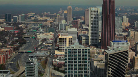 A high angle, medium pace tilt shot of the Atlanta Skyline with cars on the free Footage