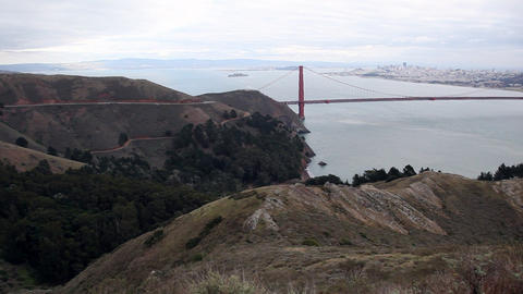 Panning view over looking the Golden Gate Bridge from the top of a look out poin Live Action