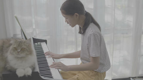 4K Ungraded Asian girl playing piano, vlog video Live Action