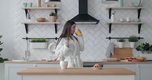 Joyful Girl having Juice and Fun in Kitchen Footage