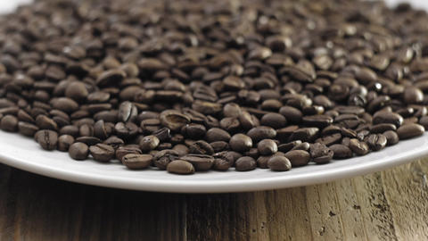 Coffee beans on plate closeup Footage