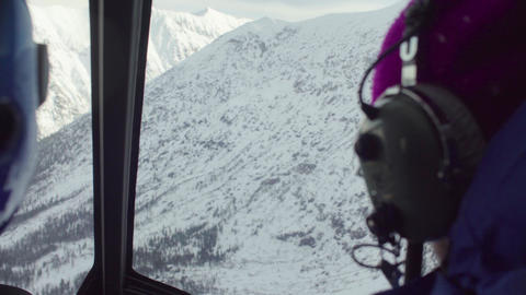 Point of view from pilot of a helicopter flying over the mountains of Siberia Live Action