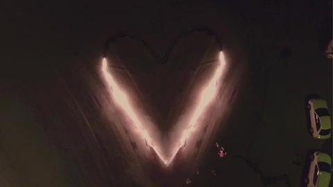 Aerial view. Burning heart of love. Fire show Stock Video Footage