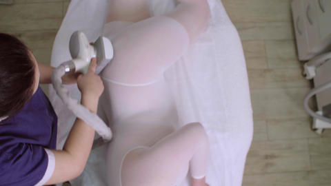 Hardware massage. Masseur makes client body massage with special device Footage