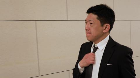 Japanese businessman walking down a hallway Live Action
