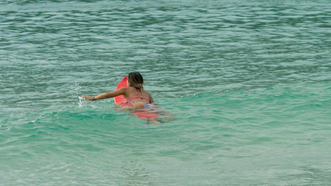 Attractive surfer woman on a surfboard floating in ocean Live Action