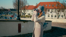 Young Tourist Lady is Walking near Medieval Castle and Taking Picture by Camera Footage