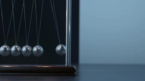Pemdulum Balls Swinging Newton's Cradle Passing Business Moment Loop closeup GIF