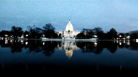A static shot of the U.S. Capitol Building at night Live Action