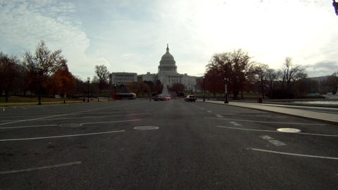 A handheld shot driving towards the U.S. Capitol Building in Washington DC Footage