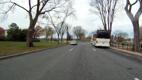 Driving on a road in Washington DC. Tour buses can be seen to the side of the ro Footage