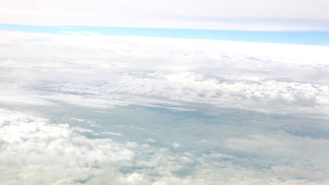 A panning shot of the top a blanket of beautiful clouds in the stunning blue sky Footage