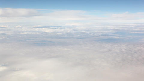 A panning shot of clusters of white clouds against a gorgeous blue sky Footage