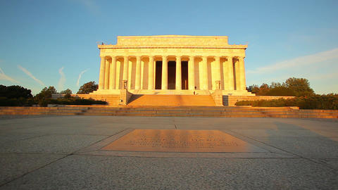 A tracking shot of the exterior of the Lincoln Memorial at sunset in Washington  Footage