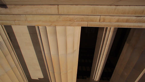 A tracking shot of a large pillar at the Lincoln Memorial in Washington DC Footage