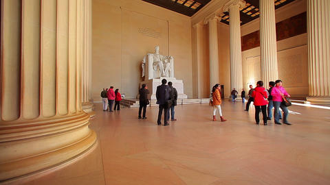 A static shot of tourists looking at the Lincoln Memorial in Washington DC Footage