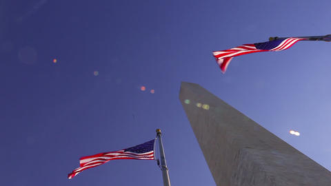 A tilt shot looking up at the Washington Monument on a windy day in Washington D Footage