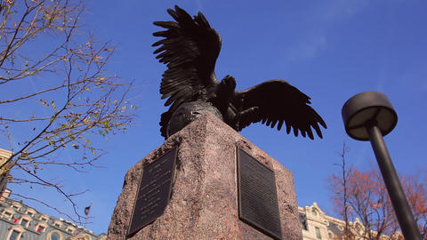 A tilt shot of a historic statue of an eagle in the daytime in Washington DC Footage
