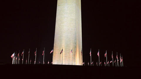 A static shot of the bottom of the Washington Monument against the darkness of t Footage