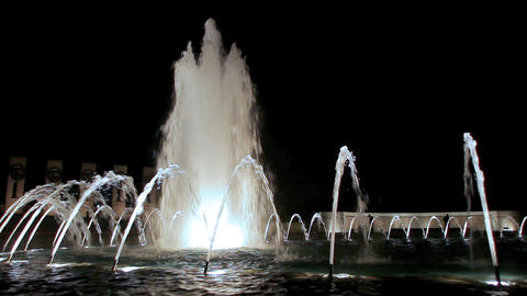 A static shot of a gorgeous water fountain at night Footage
