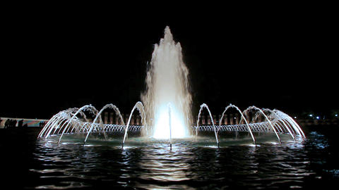 Static shot of the illuminated fountain at the World War II Memorial at night in Footage