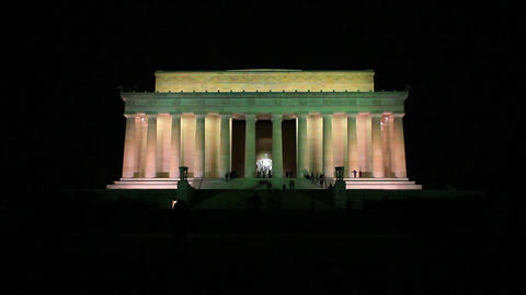 Long distance static shot of the Lincoln Memorial at night in Washington DC Footage
