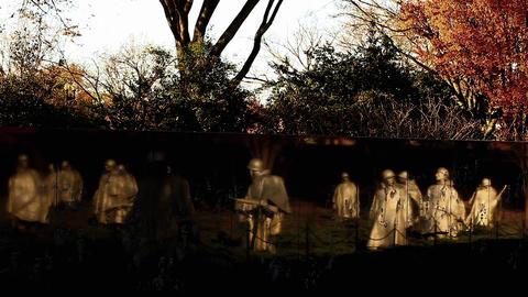 Tilt shot of the wall of the Korean War Veterans Memorial in Washington DC Live Action