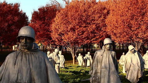 Tilt shot of statues at the Korean War Veterans Memorial in Washington DC Footage