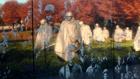 Pan of reflection of soldier statues on the Korean War Veterans Memorial in Wash Footage