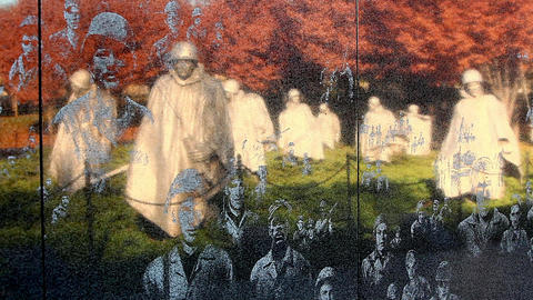Static shot of the Korean War Veterans Memorial wall in Washington DC Footage