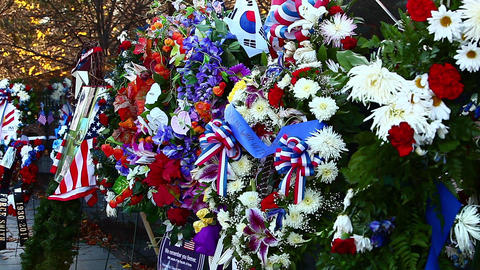Static shot of flowers and flags at the Korean War Veterans Memorial in Washingt Footage
