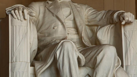 Tilting shot of the Abraham Lincoln statue inside the Lincoln Memorial in Washin Footage