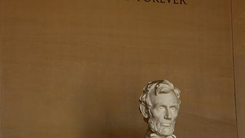 Tilt shot of dedication on Lincoln Memorial wall and Abraham Lincoln statue in W Footage