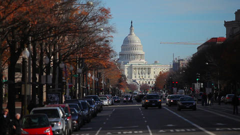 Long distance static shot of the US Capitol taken from the street in Washington  Footage