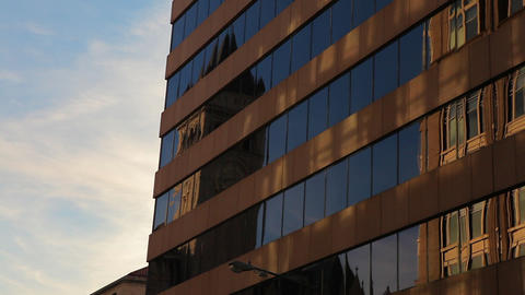Static shot of a brown building with glass windows in Washington DC Footage