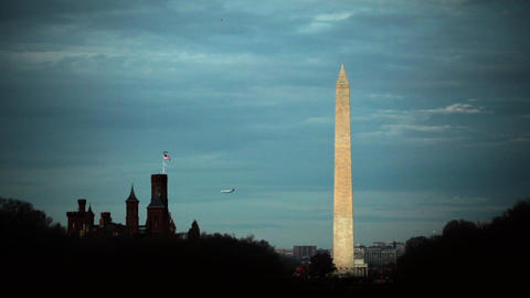 A static shot of the Washington Monument located in Washington DC against a clou Live Action