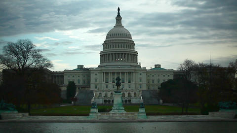 A full, static shot of the United States Capitol Dome Building against a cloudy  Footage