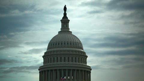 A static shot of the United States Capitol Dome Building against a blue, cloudy  Live Action