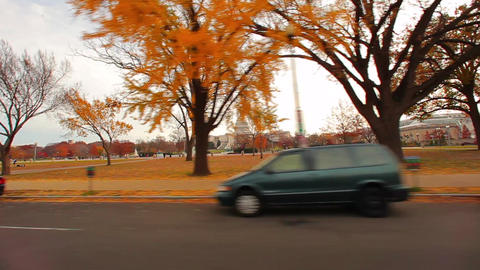 Tracking, wide shot of the United States Capitol building in autumn Live Action