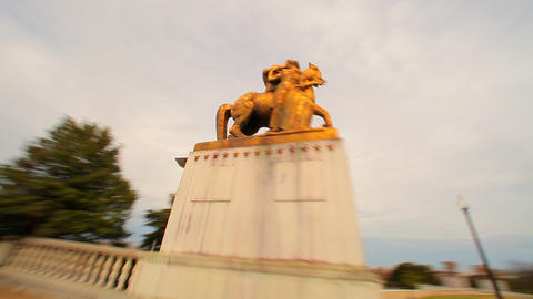 A panning shot of a statue of a horse by the National Treasury building Footage