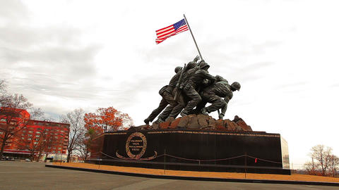 A panning up shot of the Marine Corps War Memorial on a breezy day during the mo Footage