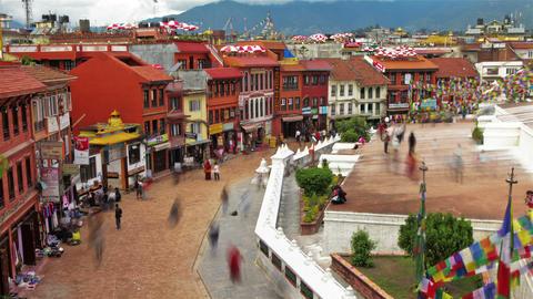 Time-lapse of people walking around the streets at Boudhanath Stupa in Kathmandu Footage