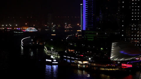 Static view of boats and skyscrapers at night near the Huangpu River Footage