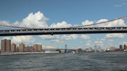 View of the Brooklyn and Manhattan Bridge while floating East River by Ferry Footage