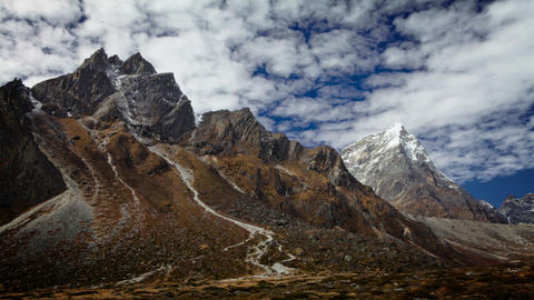 Time-lapse of rocky Himalayan peaks and passing clouds Footage