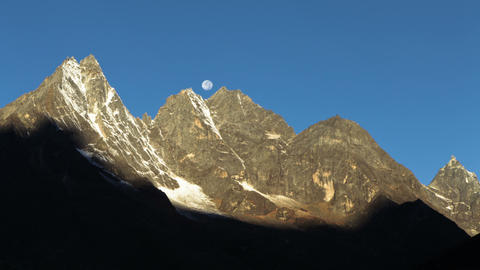 Time-lapse of the moon going behind Himalayan peaks in the morning Footage
