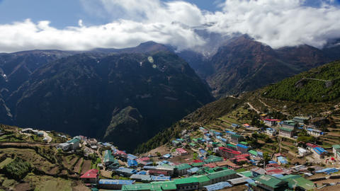 Time-lapse of a colorful village on a Himalayan mountainside Footage